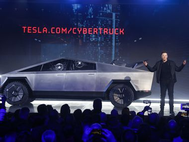 Tesla CEO Elon Musk introduces the Cybertruck at Tesla's design studio on Nov. 21, 2019, in Hawthorne, Calif. Musk is taking on the workhorse heavy pickup truck market with his latest electric vehicle. (AP Photo/Ringo H.W. Chiu)