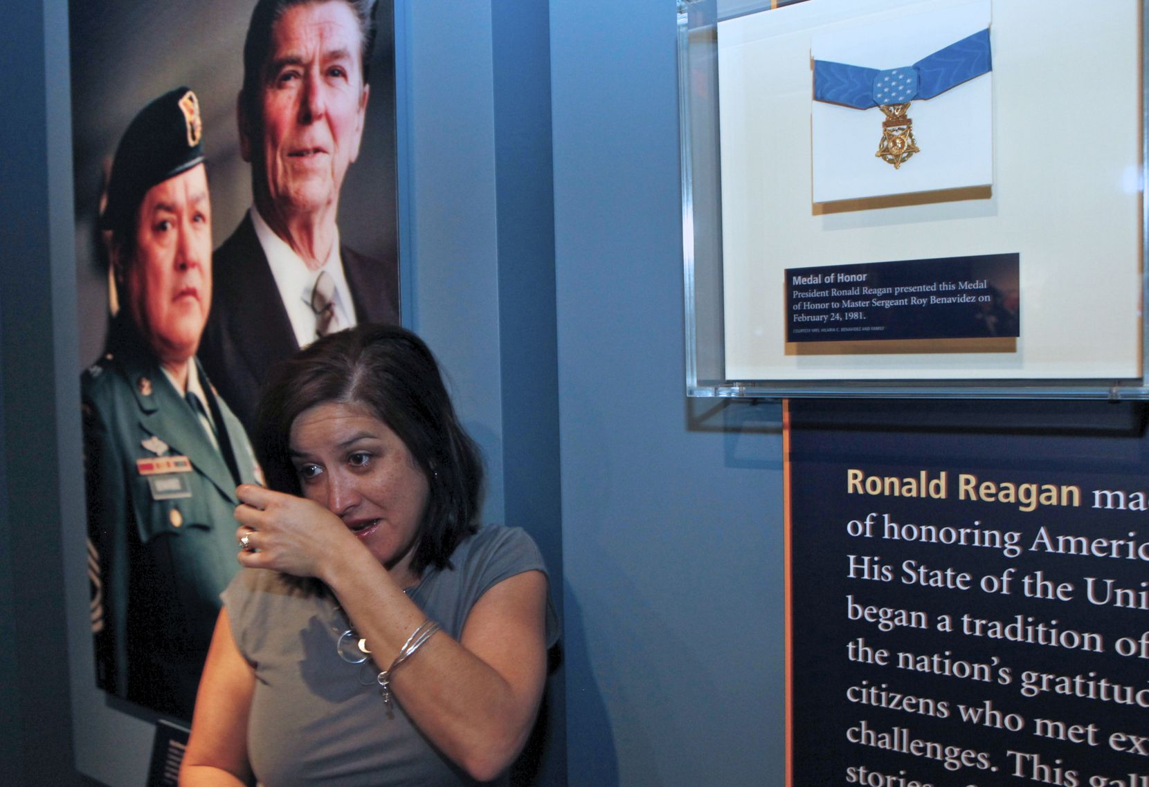 Yvette Benavidez cried as her family unveiled the Medal of Honor earned by her father, Sgt. Roy Benavidez,, at the Ronald Reagan Library in Simi Valley, Calif., in 2011. President Ronald Reagan presented the Medal of Honor to Benavidez  in 1981. (Damian Dovarqanes/The Associated Press)