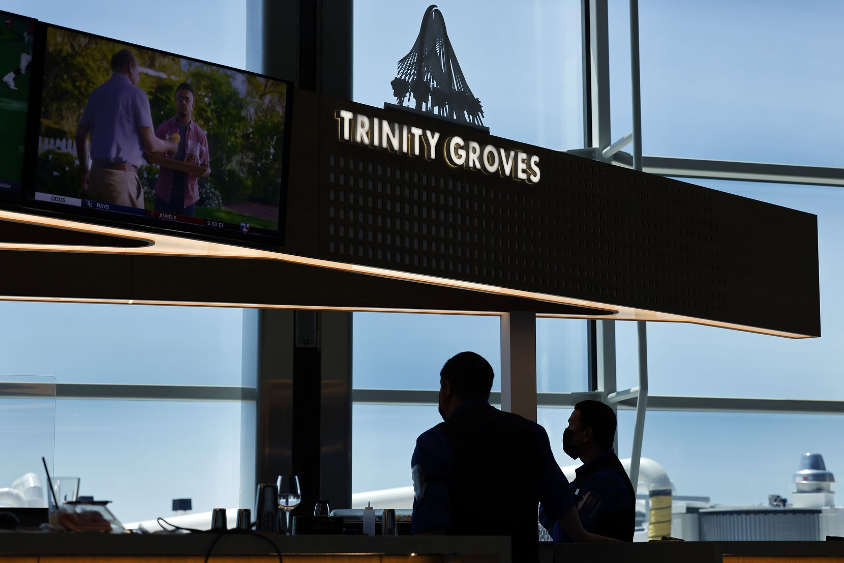 Star Concessions employees ready the Trinity Groves Bar, one of several new restaurants/bars/store fronts set to open in the Terminal D Extension at DFW International Airport.