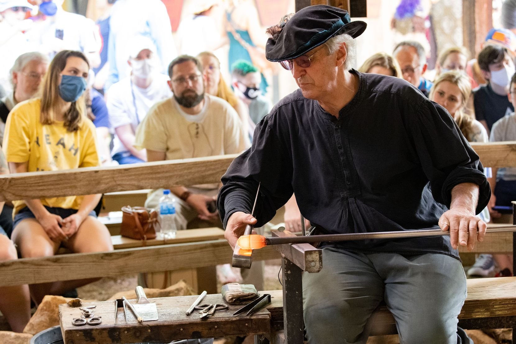 Peter Andres of Andres and Chapman demonstrates glassblowing, one of the crafts featured by artisans at the festival.