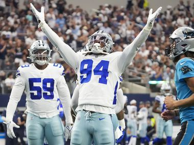 Dallas Cowboys defensive end Randy Gregory (94) celebrates after a sack during the first half an NFL football game against the Carolina Panthers at AT&T Stadium on Sunday, Oct. 3, 2021, in Arlington.