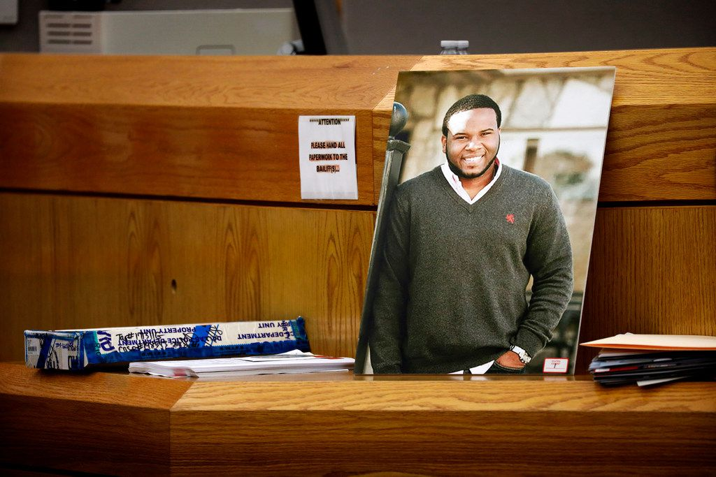 A photo of Botham Jean leaned against Judge Tammy Kemp's bench during Amber Guyger's murder trial.