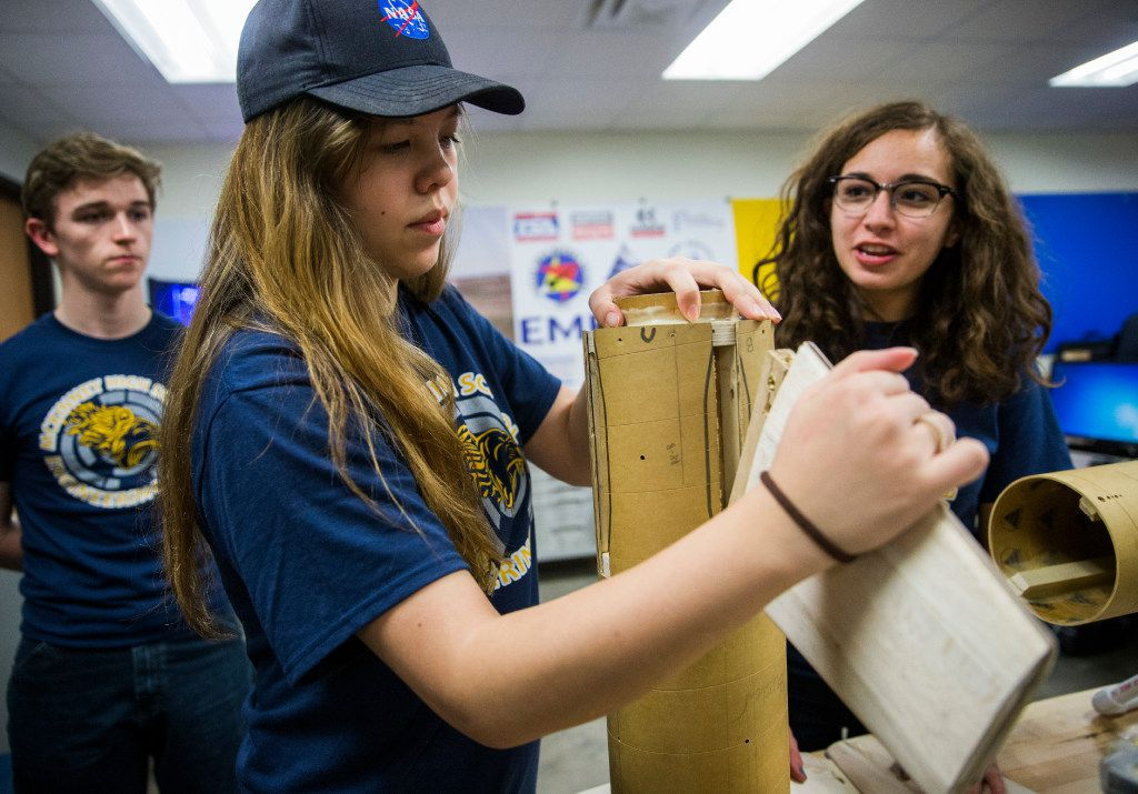 Kathryn Lehocky, 18, center, project manager of the McKinney High School Flying Lions Rocketry Club, disassembles their nearly ten foot long rocket on Tuesday, March 14, 2017 at McKinney High School in McKinney, Texas. Kyle Myscich, 16, is at left and Alex Macias, 16, is at right. The team has been awarded an eight-month unfunded NASA contract to design and build a reusable high-powered rocket and payload that they will launch to an altitude of one mile above ground level. In April, they will join 17 other high school teams at NASA's Marshall Space Flight Center in Huntsville, Alabama. (Ashley Landis/The Dallas Morning News)