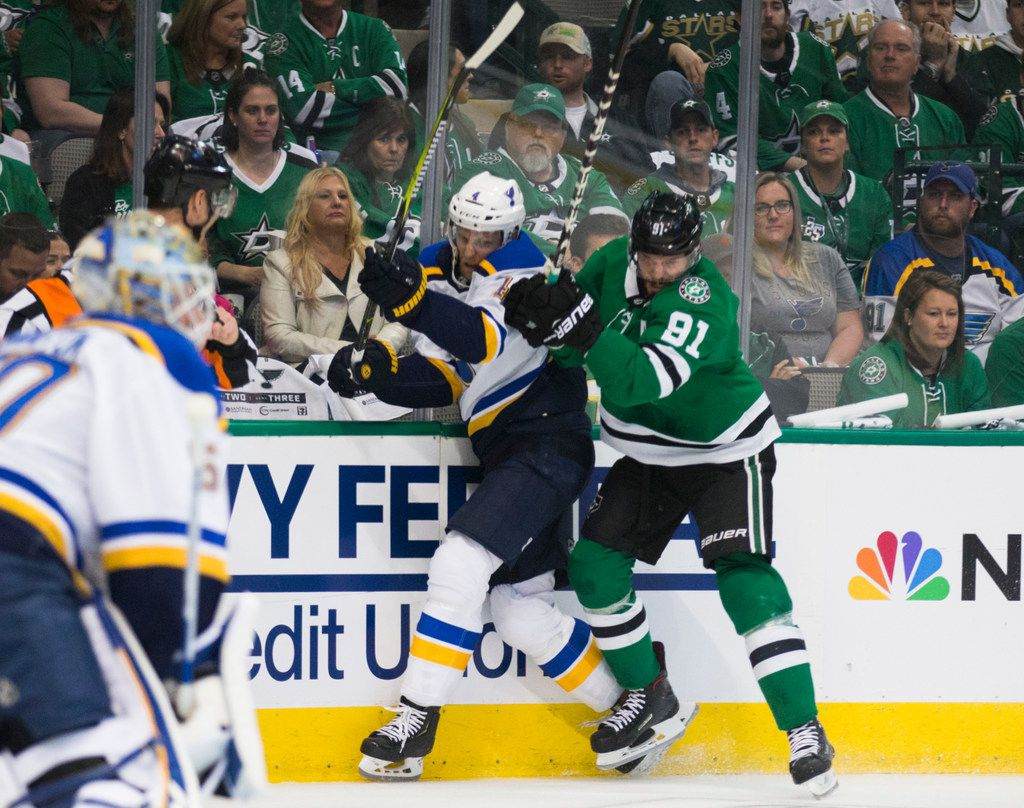 Dallas Stars center Tyler Seguin (91) takes St. Louis Blues defenseman Carl Gunnarsson (4) to the board behind the goal during the first period of Game 3 of Round 2 of NHL playoffs between the Dallas Stars and the St. Louis Blues on Monday, April 29, 2019 at American Airlines Center in Dallas. (Ashley Landis/The Dallas Morning News)