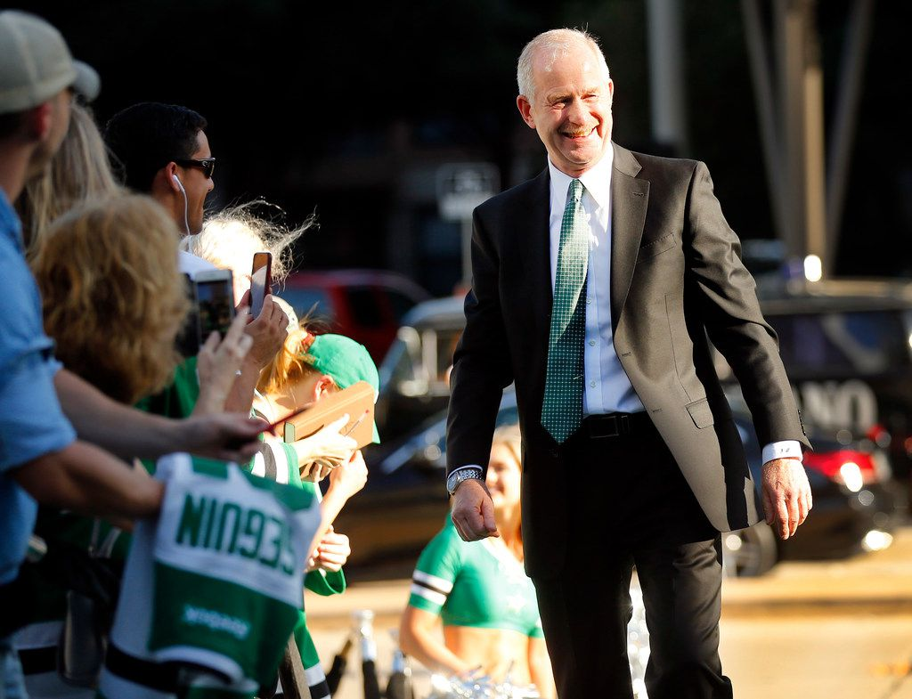 FILE - Stars general manager Jim Nill is welcomed by fans on the green carpet at American Airlines Center before a game in Dallas on Thursday, Oct. 4, 2018.