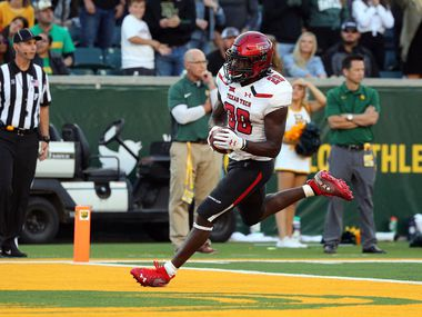 WACO, TEXAS - OCTOBER 12: SaRodorick Thompson #28 of the Texas Tech Red Raiders scores a touchdown in the fourth quarter against the Baylor Bears on October 12, 2019 in Waco, Texas.