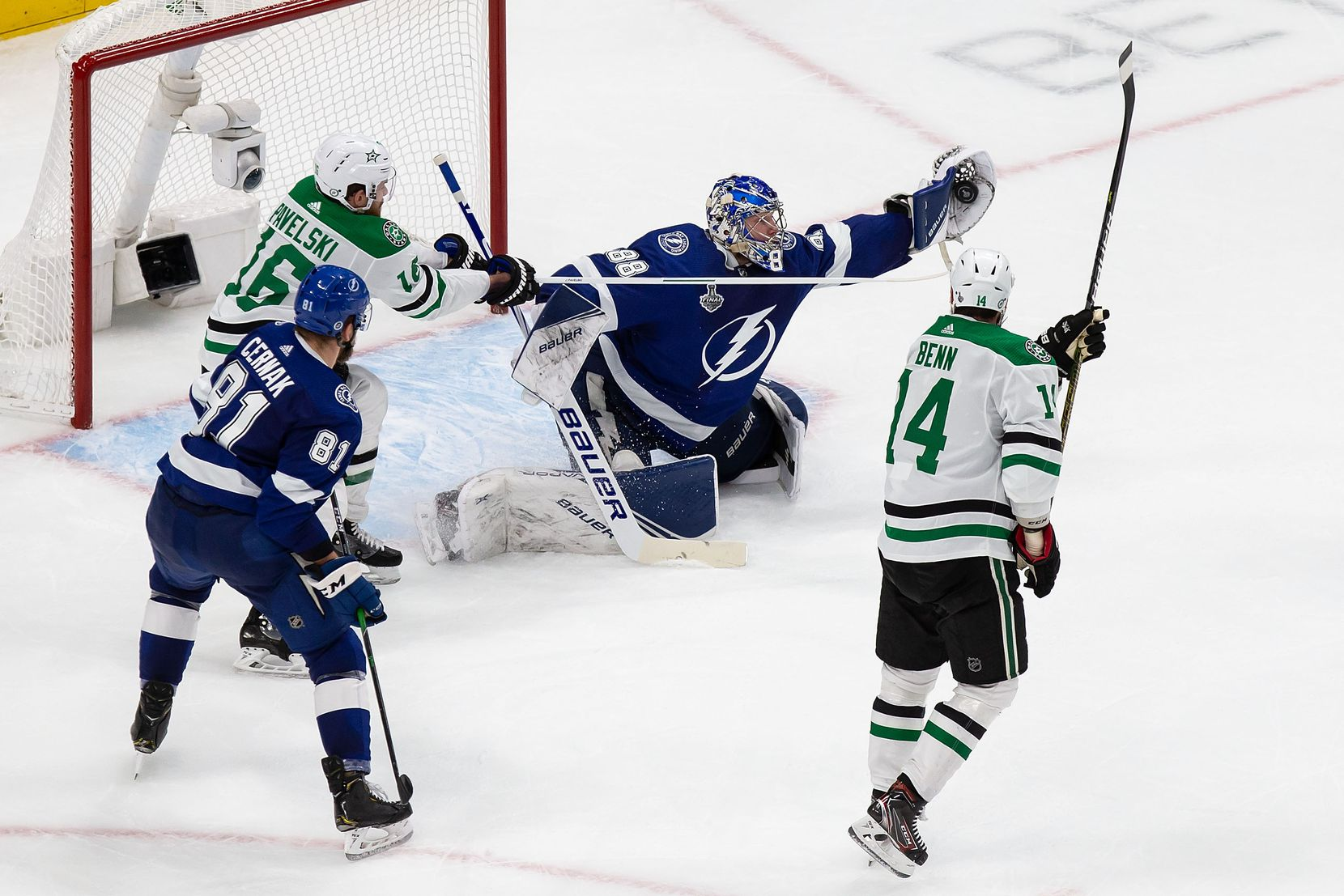 Joe Pavelski (16) and Jamie Benn (14) of the Dallas Stars attack the net as goaltender Andrei Vasilevskiy (88) of the Tampa Bay Lightning makes a save during Game Two of the Stanley Cup Final at Rogers Place in Edmonton, Alberta, Canada on Monday, September 21, 2020. (Codie McLachlan/Special Contributor)