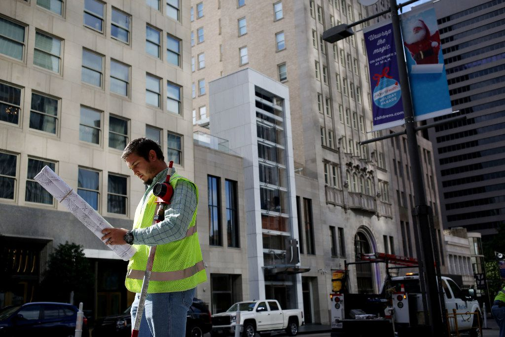 Jesse Gerich surveys as Oncor is preparing a GPS grid of its facilities in downtown Dallas Thursday November 17, 2016. (Andy Jacobsohn/The Dallas Morning News)