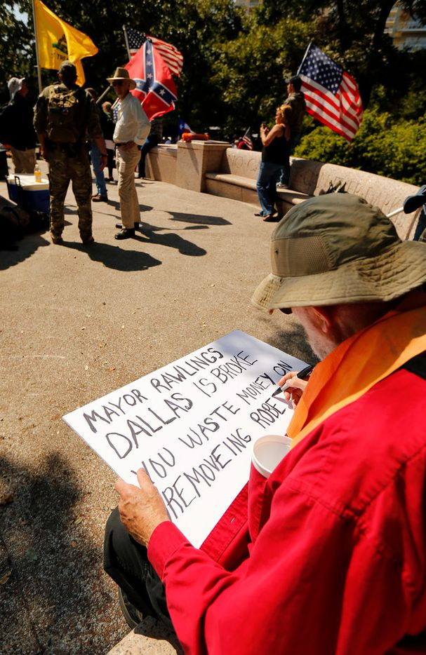 James Murphy of Red Oak created a protest sign last month before the This Is Texas Freedom Force protest over removal of the Robert E. Lee statue from an Oak Lawn park.