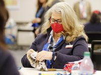 American Airlines employee Nancy Gergas works on making masks for employees at DFW International Airport on Wednesday, April 8, 2020. American Airlines, unable to procure masks through the private industry, is making its own for employees.