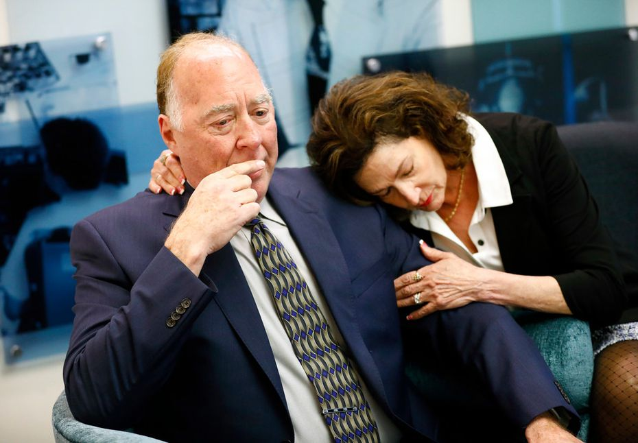 Former American Airlines Capt.Jay Straub of Denton is comforted by his wife, Letha Straub, as he recounts his debilitating injury after a jet bridge collapse sent him crashing to the tarmac at DFW International Airport in 1999. They sat down and talked about their situation at the Allied Pilots Association offices in Fort Worth. American Airlines pilots on long-term disability are pushing the company to improve benefits.