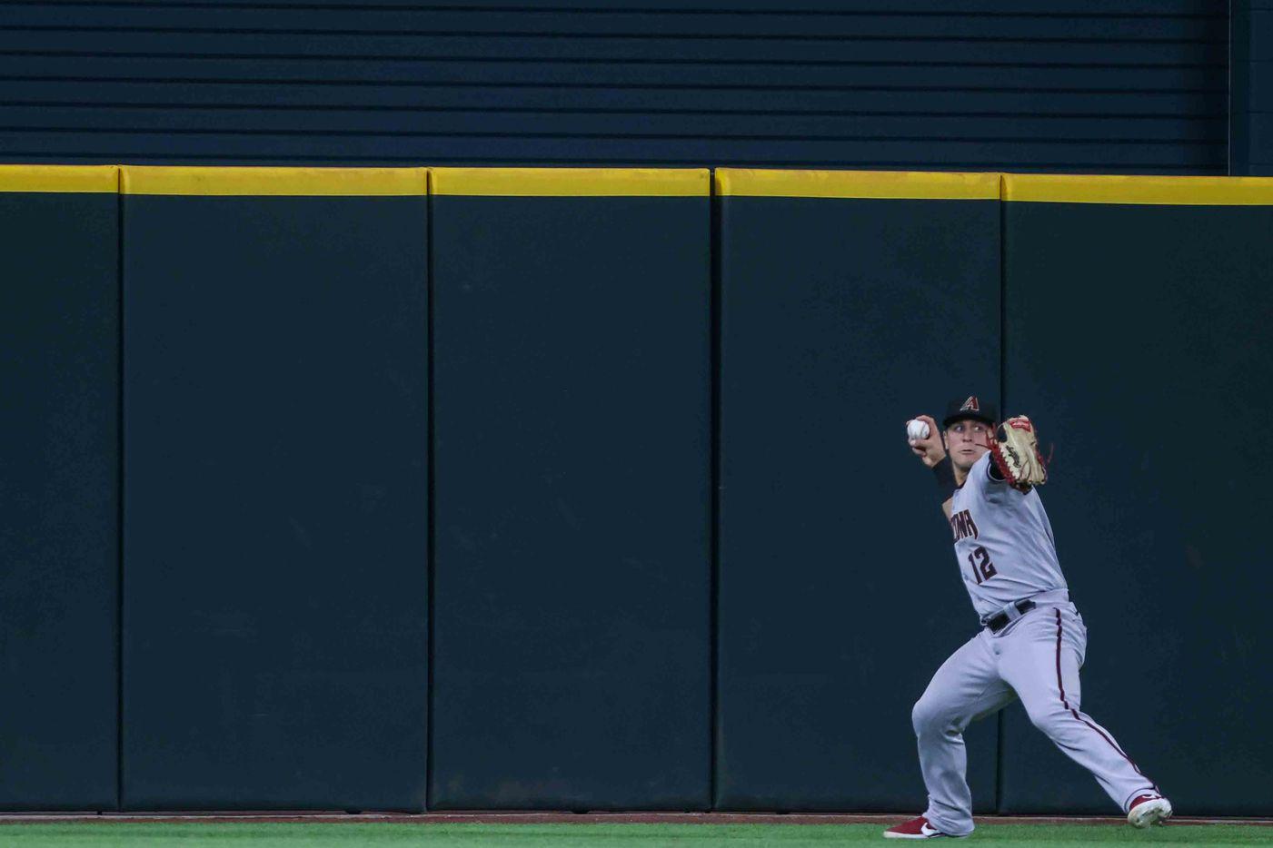 Daulton Varsho (12) catches a fly during Arizona Diamondbacks at Texas Rangers game at the Globe Life Field in Arlington, Texas on Wednesday, July 28, 2021. (Lola Gomez/The Dallas Morning News)