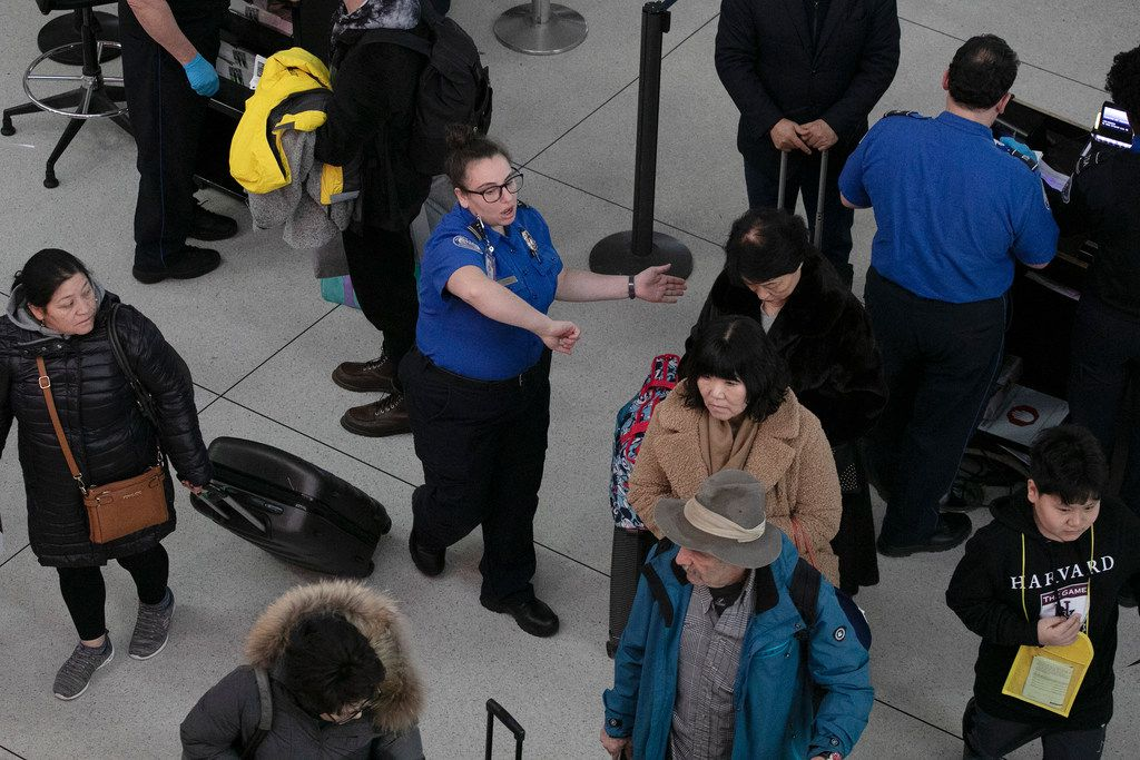 A TSA agent directs passengers through a security checkpoint at New York's John F. Kennedy International Airport on Jan. 7, 2019.