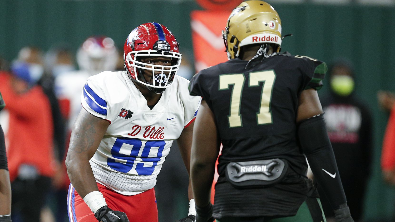DeSoto junior guard Joshua Straw (77) looks on as Duncanville junior defensive tackle Quincy Wright (99) celebrates a sack during the first half of a Class 6A Division I Region II final high school football game, Saturday, January 2, 2021.