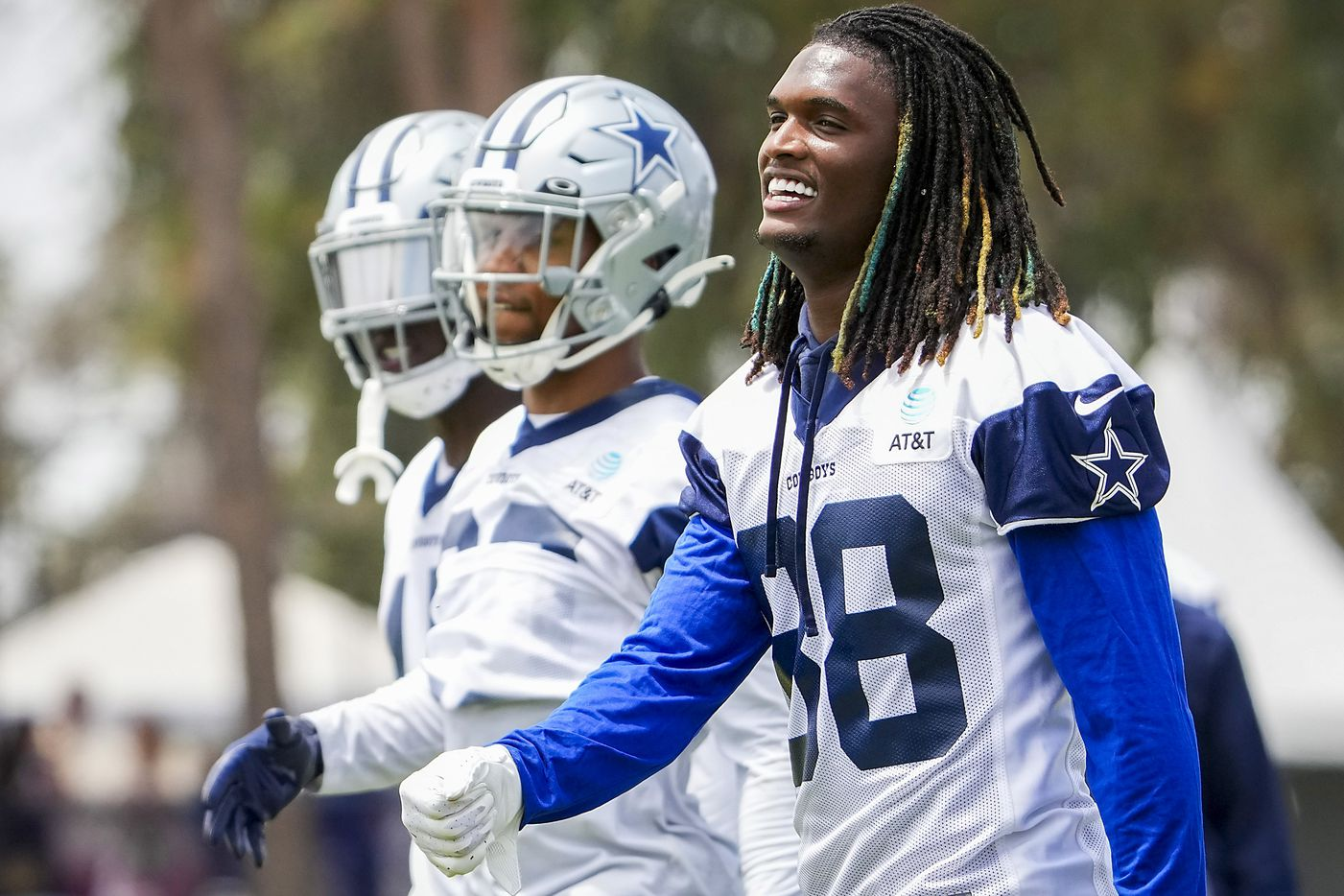 Dallas Cowboys wide receiver CeeDee Lamb (88) smiles as he walks between drills during a practice at training camp on Saturday, July 24, 2021, in Oxnard, Calif.