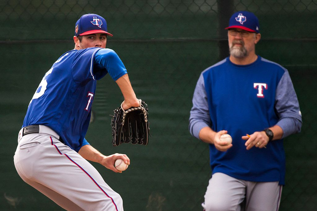 Texas Rangers starting pitcher Cole Hamels throws in the bullpen under the eye of pitching coach Doug Brocail during the first spring training workout for pitchers and catchers at the team's training facility on Thursday, Feb. 15, 2018, in Surprise, Ariz. (Smiley N. Pool/The Dallas Morning News)