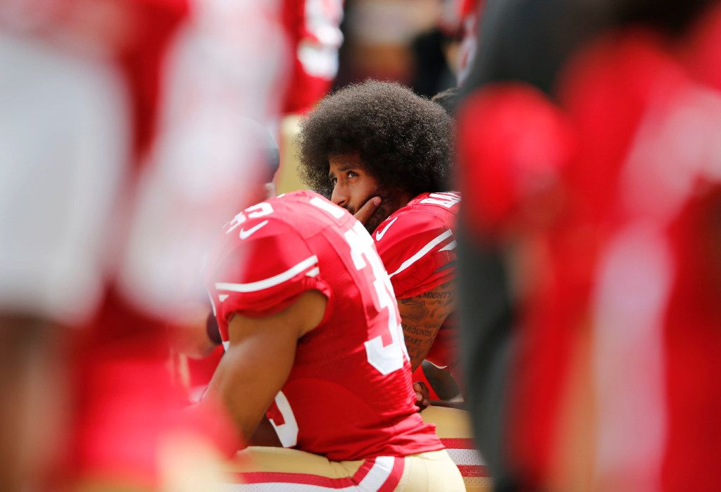 San Francisco 49ers quarterback Colin Kaepernick kneels during the national anthem before a game against the Dallas Cowboys in Santa Clara, Calif., on Oct. 2, 2016.