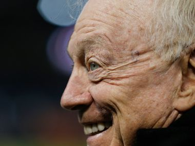 FILE - Cowboys owner Jerry Jones converses along the sideline before a game against the Bears on Thursday, Dec. 5, 2019, at Soldier Field in Chicago.