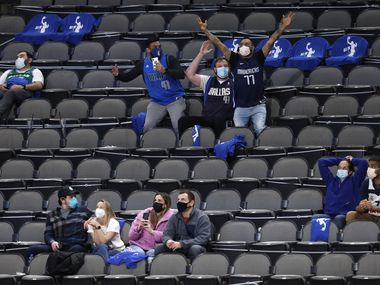 Dallas Mavericks fans celebrate as they are shown on the big screen in a game against the Minnesota Timberwolves during the fourth quarter of play at American Airlines Center on Monday, February 8, 2021 in Dallas. The Dallas Mavericks defeated the Minnesota Timberwolves 127-122. (Vernon Bryant/The Dallas Morning News)