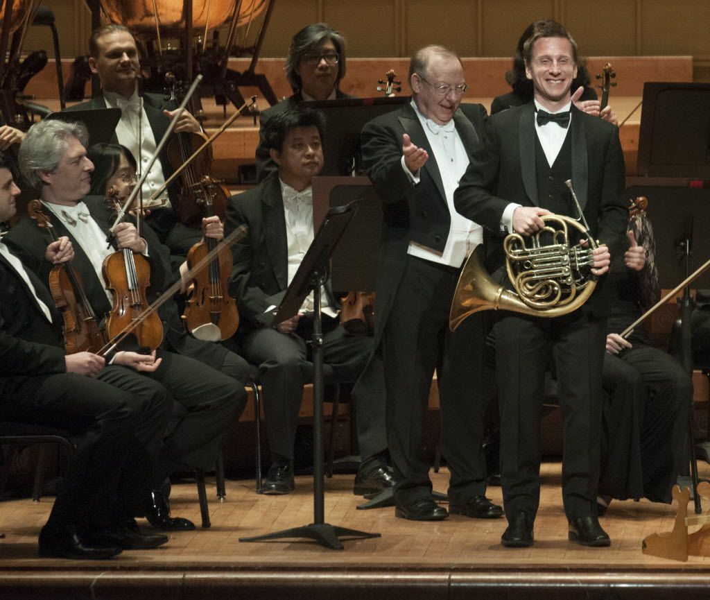 Conductor Nicholas McGegan introduced principal horn David Cooper to the audience at the Morton H. Meyerson Symphony Center on Jan. 22, 2015.