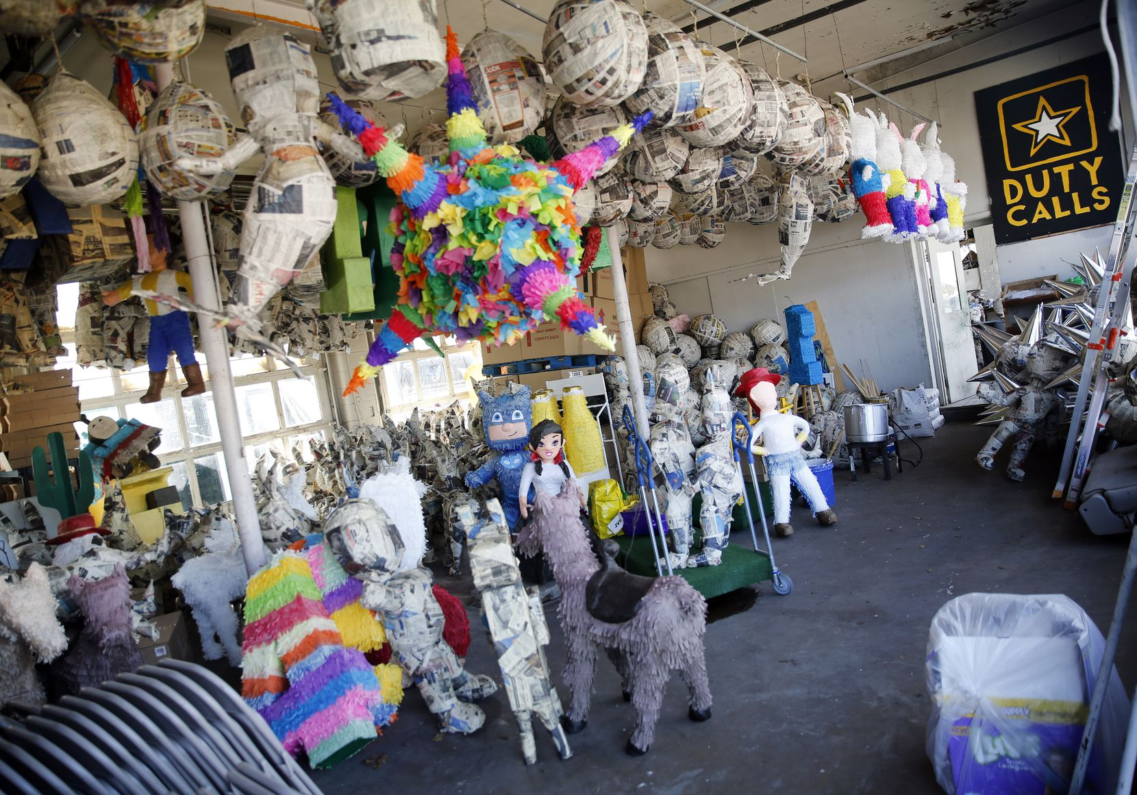 The building next door to ABC Party, which the De La Fuente couple also owns and originally used for a produce store, now houses the family's custom piñata-making operation. Many partial piñatas sit just as they were when the coronavirus pandemic closed down ABC Party.