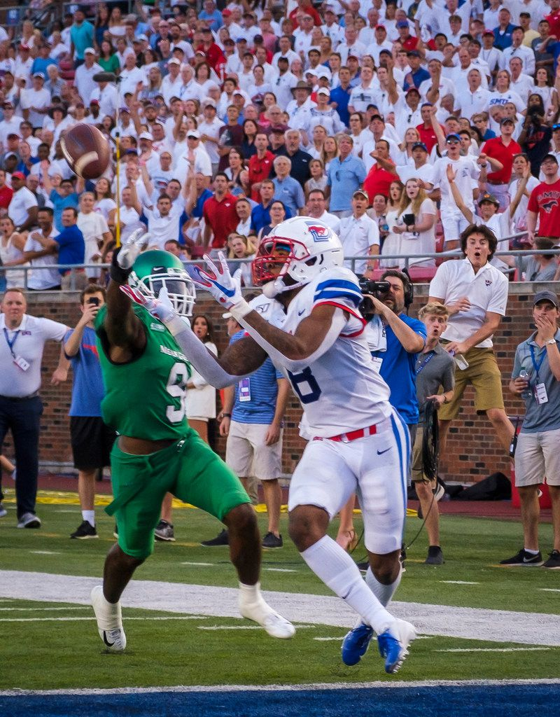 SMU wide receiver Reggie Roberson Jr. (8) catches a 31-yard touchdown pass as UNT defensive back Nick Harvey (9) defends during the first half of an NCAA football game at Ford Stadium on Saturday, Sept. 7, 2019, in Dallas. (Smiley N. Pool/The Dallas Morning News)