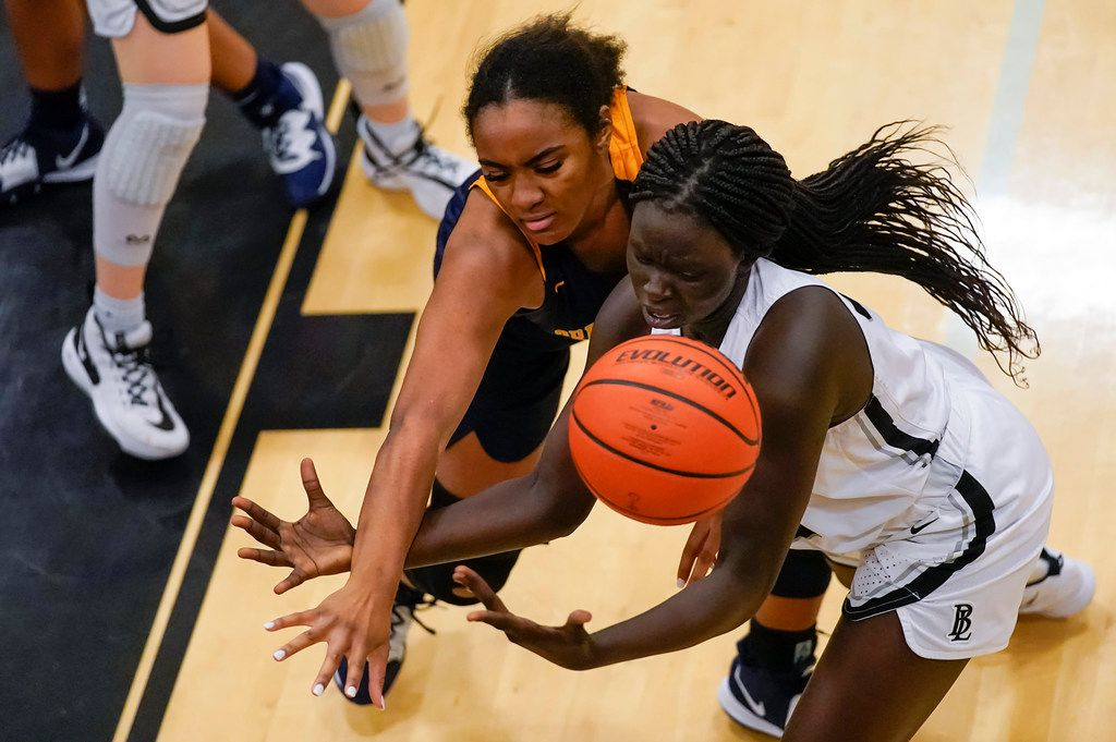 Bishop Lynch's Ayen Angoi (right) fights for a rebound against Prestonwood Christian forward Morgan Hervey (35) during a TAPPS 2-6A high school girls basketball game on Friday, Feb. 7, 2020, in Dallas. Bishop Lynch won the game 59-54. (Smiley N. Pool/The Dallas Morning News)