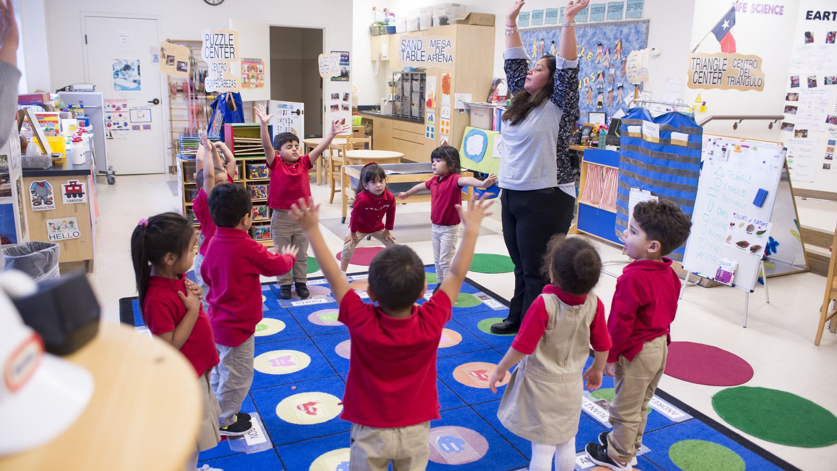 Pre-K teacher Juanita Cabrales leads her 3-year-old students in breathing exercises at the Momentous School.