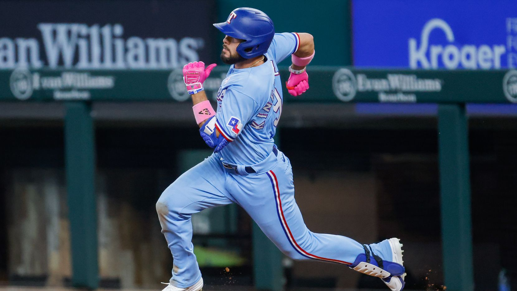 Texas Rangers third baseman Isiah Kiner-Falefa (9) doubles to right at the bottom of the eighth inning against the Seattle Mariners at Globe Life Field on Sunday, May 9, 2021, in Arlington. The Rangers won, 10-2.