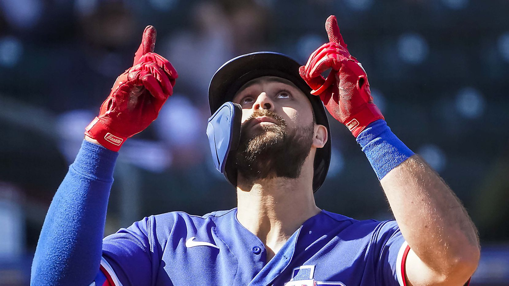 Texas Rangers outfielder Joey Gallo celebrates after hitting a 3-run home run during the fifth inning of a spring training game against the San Diego Padres at Surprise Stadium on Thursday, March 4, 2021, in Surprise, Ariz.