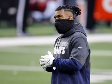 Dallas Cowboys running back Ezekiel Elliott didn't dressed out for pregame warmups before facing the San Francisco 49ers at AT&T Stadium in Arlington, Texas, Sunday, December 20, 2020. (Tom Fox/The Dallas Morning News)