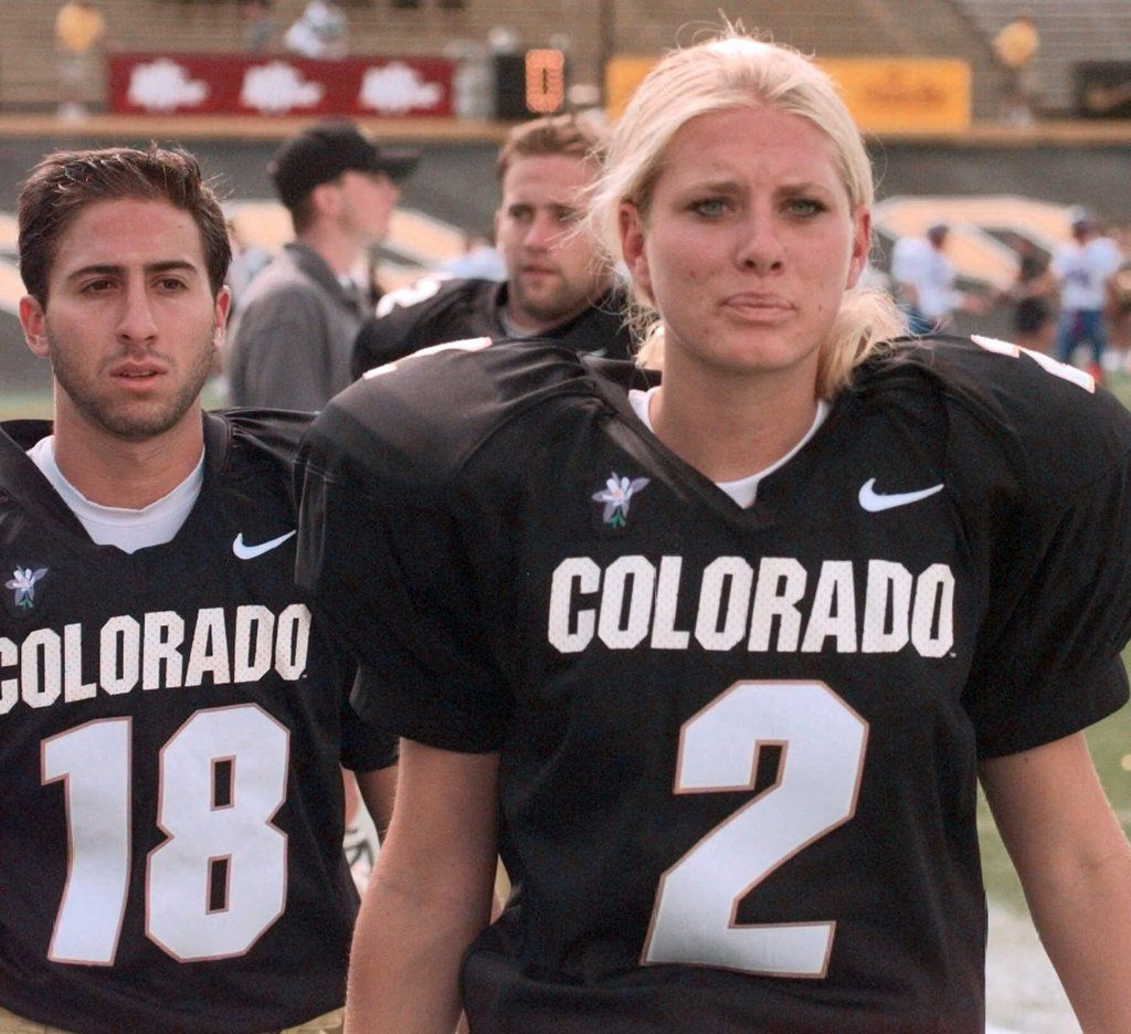 Colorado backup place kickers Katie Hnida (2) and Matt Altman head to the sidelines after warming up prior to Colorado's game with Kansas at Folsom Field in Boulder, Colo., Saturday, Sept. 18, 1999. Hnida, a freshman, dressed out for a game for the first time Saturday, though she did not play. She played high school football at Cherry Creek High School in Denver.
