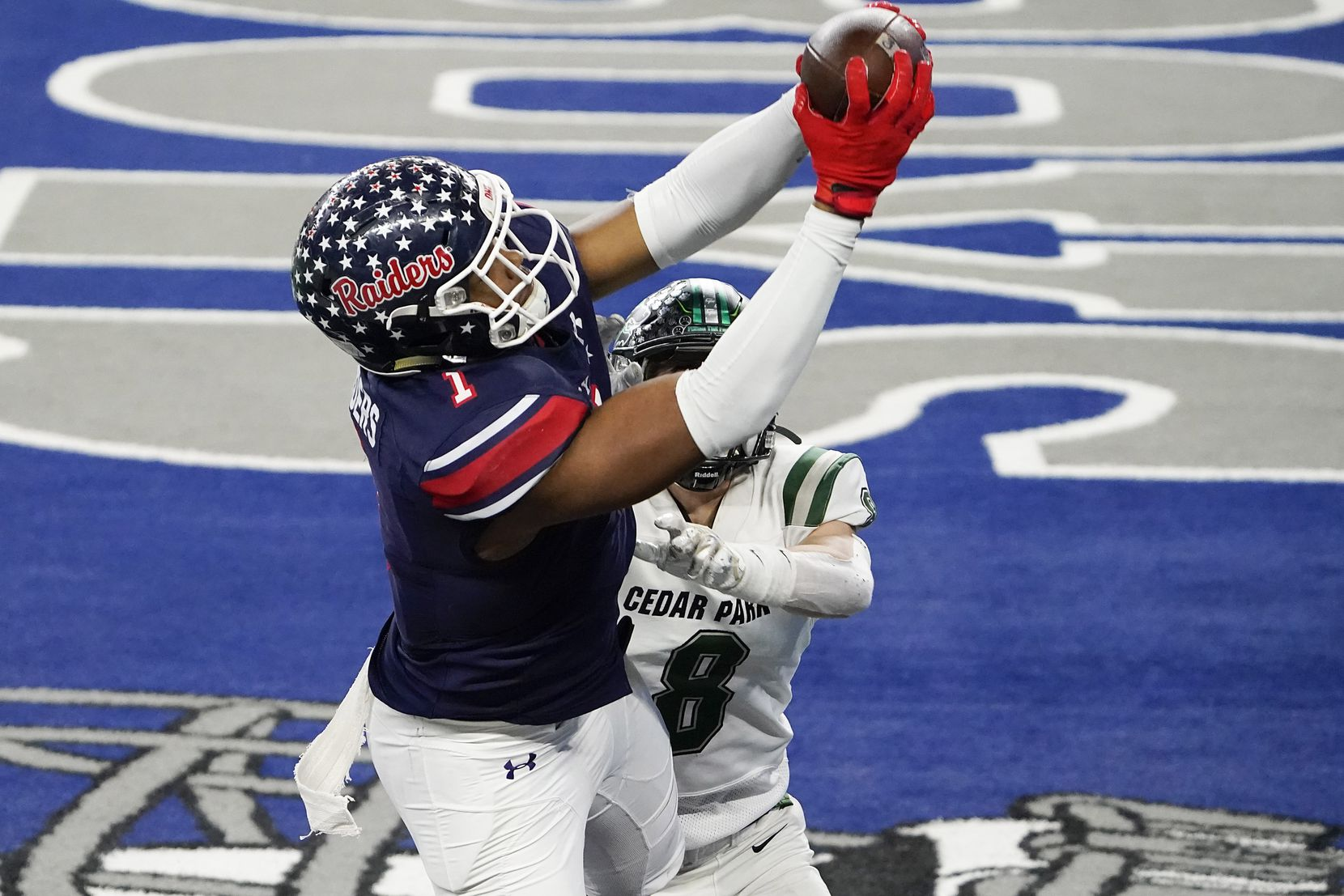 Denton Ryan wide receiver Ja'Tavion Sanders (1) catches a touchdown pass from quarterback Seth Henigan as Cedar Park defensive back Casyn Wiesenhutter (8) defends during the second half of the Class 5A Division I state football championship game at AT&T Stadium on Friday, Jan. 15, 2021, in Arlington, Texas. Ryan won the game 59-14. (Smiley N. Pool/The Dallas Morning News)