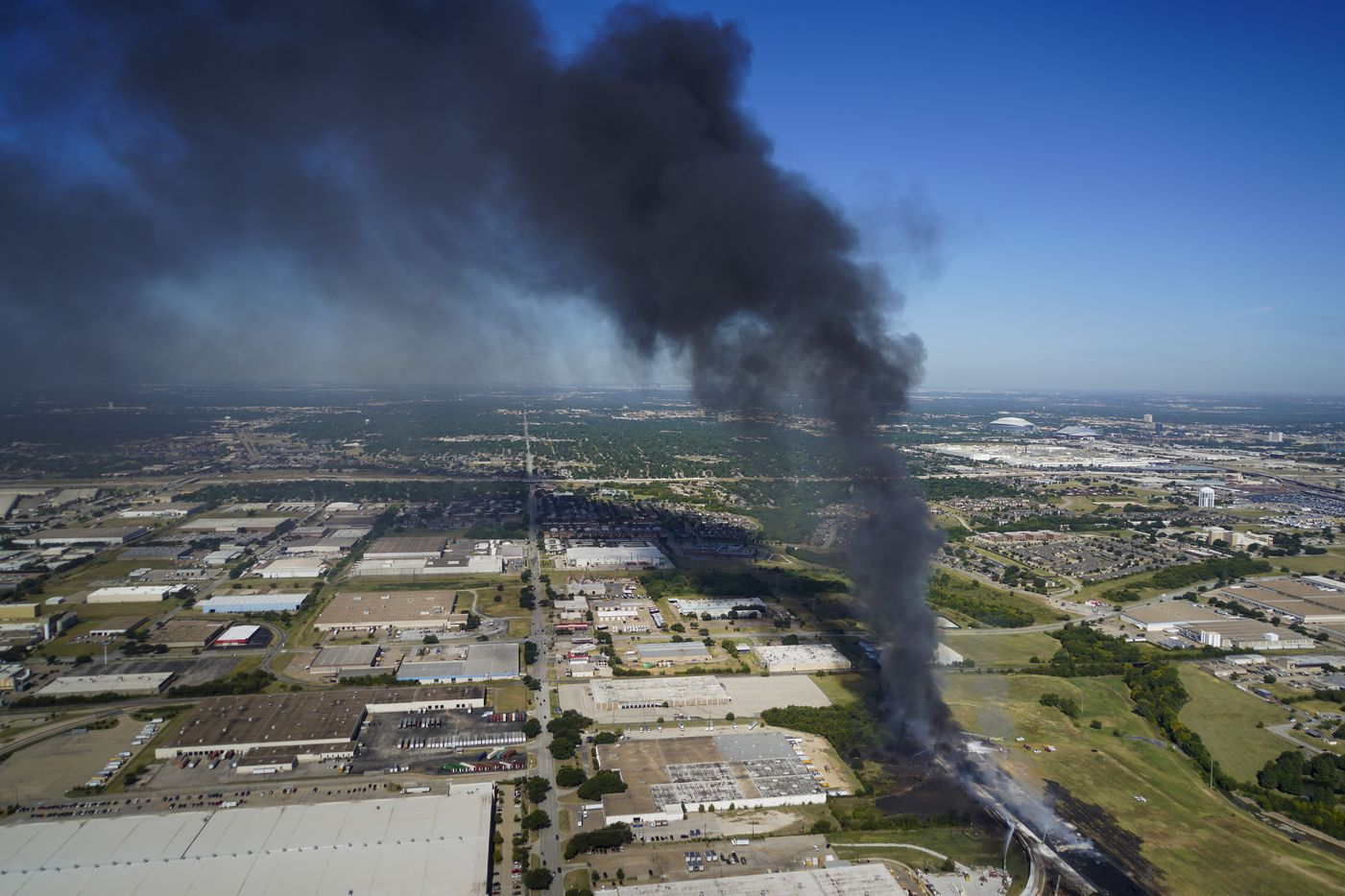 Aerial view of fire crews working at the site of a massive blaze in an industrial area on Wednesday, Aug. 19, 2020 in of Grand Prairie, Texas.