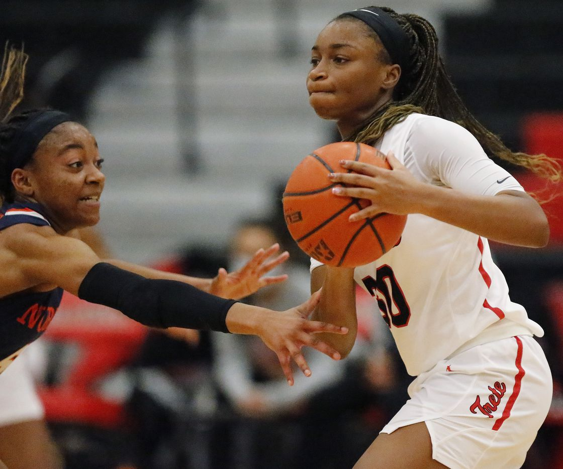 Frisco Liberty High School guard Jazzy Owens-Barnett (30) makes a pass while defended by McKinney North High School guard Yarnia Evans (5) during the fourth quarter as McKinney North High School hosted Frisco Liberty High School in a Class 5A girls bi-district playoff game held at Braswell High School in Aubrey on Thursday, February 11, 2021.  (Stewart F. House/Special Contributor)