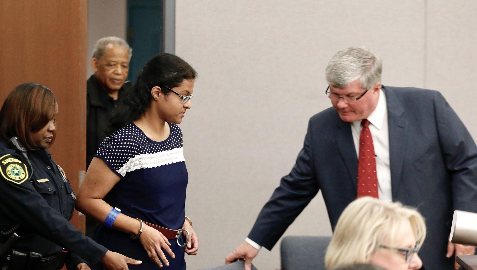 Sini Mathews, mother of Sherin Mathews, entered Judge Cheryl Lee Shannon's courtroom at the Henry Wade Juvenile Justice Building on Dec. 5, 2017.