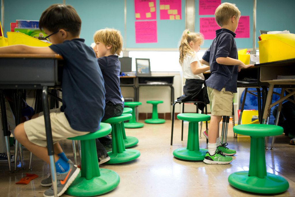Students sit on wobble stools donated through DonorsChoose.org during second-grade reading class at Hexter Elementary. (Ting Shen/Staff Photographer)