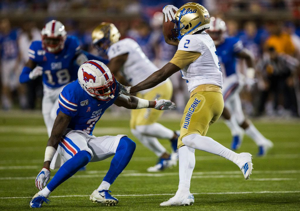 SMU Mustangs cornerback Robert Hayes Jr. (7) is pushed away by Tulsa Golden Hurricane wide receiver Keylon Stokes (2) during the second quarter of an NCAA football game between Tulsa and SMU on Saturday, October 5, 2019 at Ford Stadium on the SMU campus in Dallas. (Ashley Landis/The Dallas Morning News)