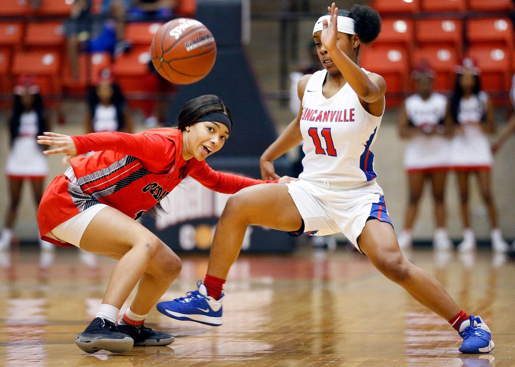 Duncanville's Tristen Taylor (11) swats the ball away from Cedar Hills' Iyonia Smith (5) during the first half of the Class 6A Region I championship game at Wilkerson-Greines Activity Center in Fort Worth, Saturday, February 29, 2020. (Tom Fox/The Dallas Morning News)