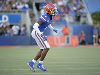 FILE - Florida defensive back CJ Henderson (1) follows a play during the first half of a game against Miami on Saturday, Aug. 24, 2019, in Orlando, Fla. (AP Photo)