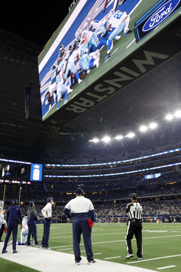 After throwing a red flag, Dallas Cowboys head coach Mike McCarthy watches the touchdown replay by Dak Prescott on the video board during the second quarter at AT&T Stadium in Arlington, Monday, September 27, 2021. The ruling was upheld and the Cowboys didn't get the score. (Tom Fox/The Dallas Morning News)
