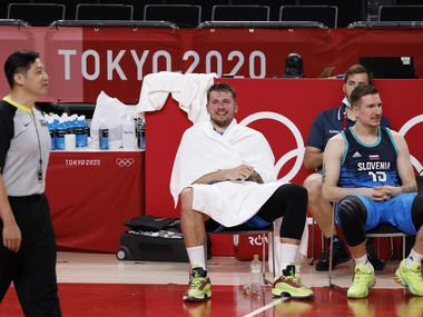 Slovenia's Luka Doncic (77) laughs in the final minutes of play in the second half against Argentina during the postponed 2020 Tokyo Olympics at Saitama Super Arena on Monday, July 26, 2021, in Saitama, Japan.