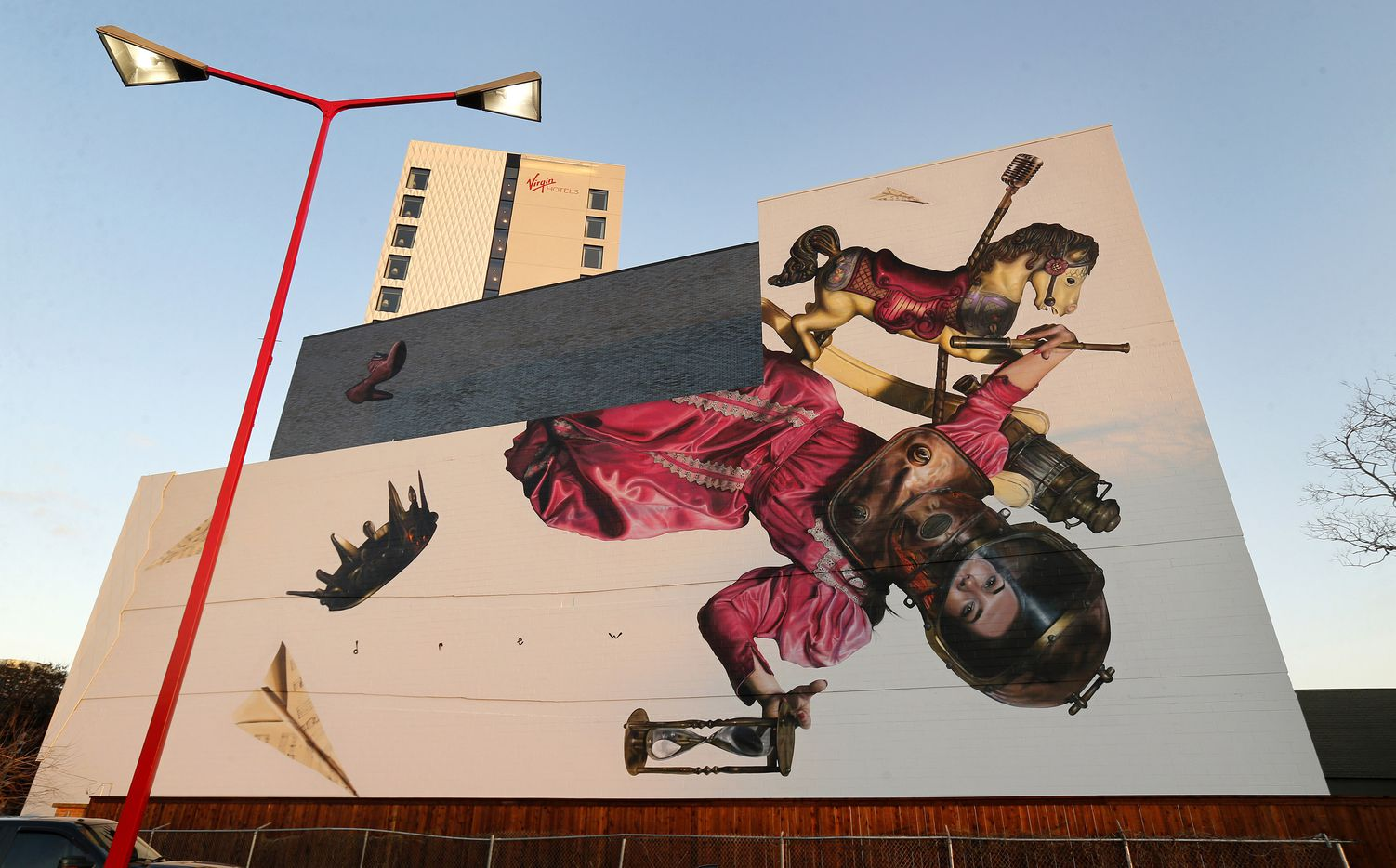 """Artist Drew Merritt painted """"Amor Vincit Omnia"""" (Latin for """"Love conquers all"""") mural on the backside of the Virgin Hotel in the Design District area of Dallas. Photographed, Thursday, February 20, 2020."""