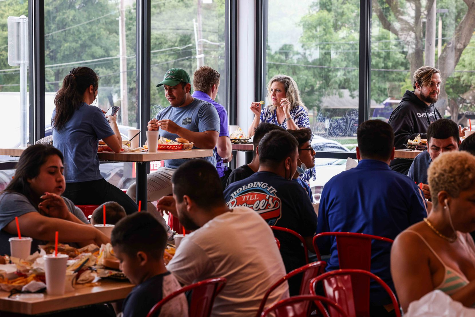 On opening day, Friday, May 28, 2021, Dave's Hot Chicken in Dallas was packed and the drive-through was busy.