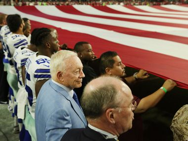 Dallas Cowboys owner Jerry Jones stand locked in arms with his team and personnel during the playing of the United States National Anthem before a National Football League game between the Dallas Cowboys and the Arizona Cardinals at University of Phoenix Stadium in Glendale, Arizona on Monday September 25, 2017. The team kneeled for a moment prior to the anthem.