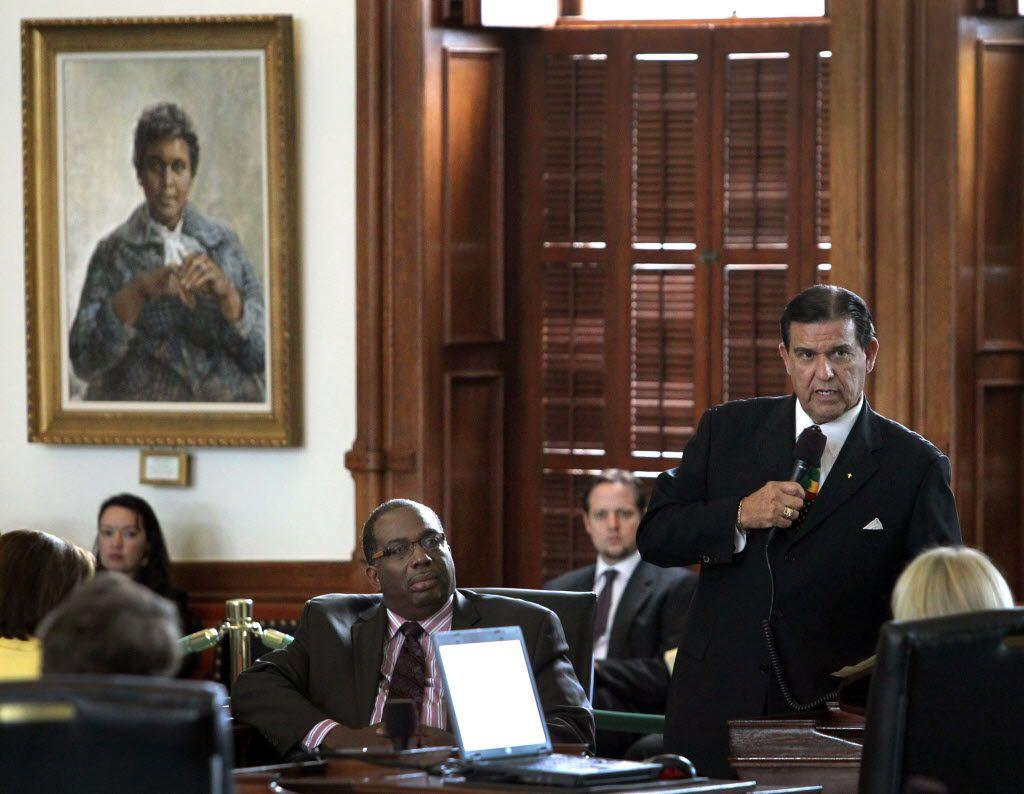 State Sen. Eddie Lucio Jr. of Brownsville (right) on the Texas Senate floor in 2013. (Louis DeLuca/DMN)
