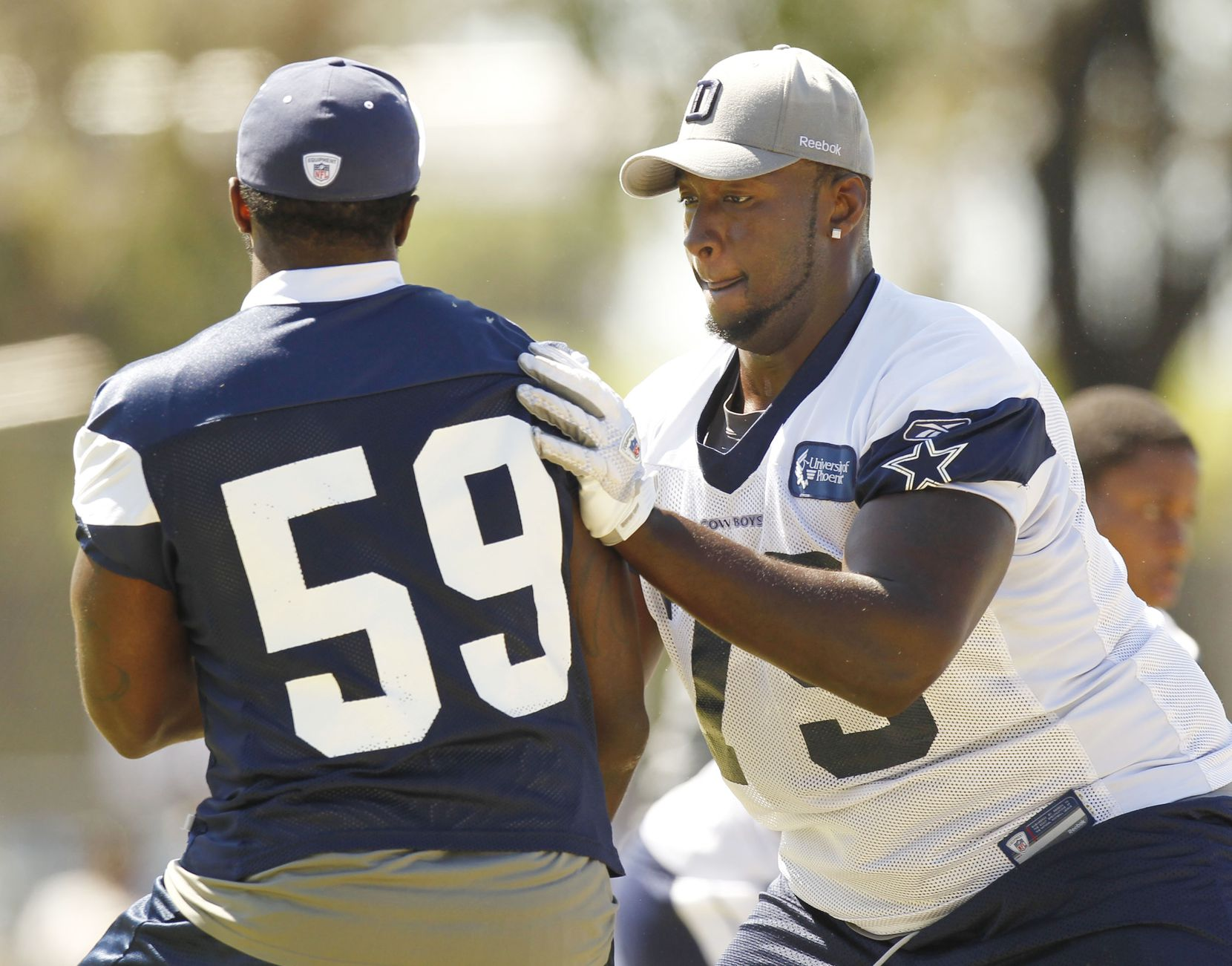 Dallas Cowboys offensive linemane Robert Brewster (79) blocks linebacker Brandon Williams (59)  during afternoon practice at training camp in Oxnard, California, on August 19, 2010. (Michael Ainsworth/The Dallas Morning News)