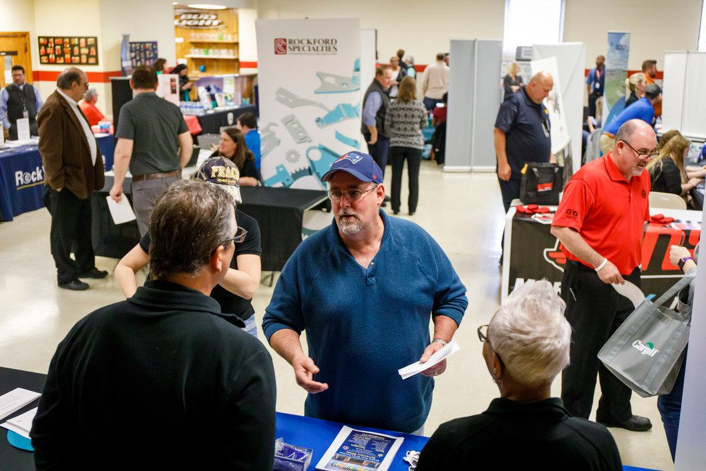 Mike Dovey talks to prospective employers during a job fair at the UAW Hall in Belvidere, Ill. Dovey was laid off by Fiat Chrysler.