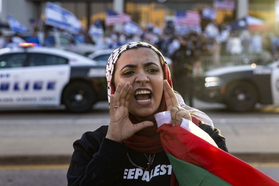 Hibah Abudaabes led chants with hundreds of fellow demonstrators attending the Palestinian side of a demonstration on Preston Road in Far North Dallas on Wednesday.