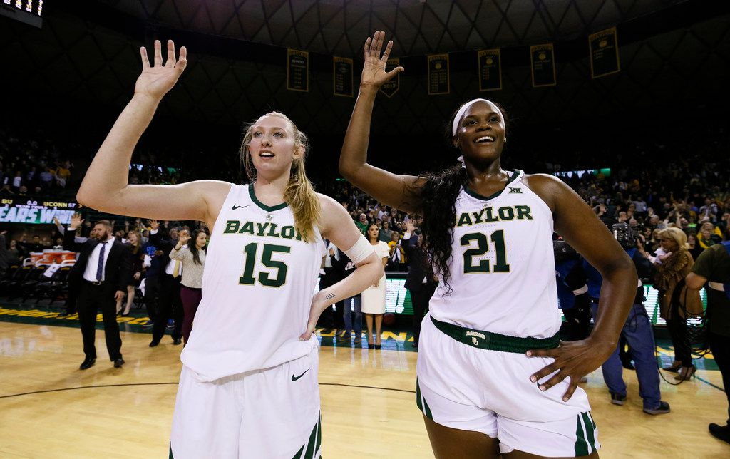 Baylor forward Lauren Cox (15) and center Kalani Brown (21) stand during the playing of the school fight song following the team's 68-57 victory over No. 1 Connecticut in an NCAA college basketball game Thursday, Jan. 3, 2019, in Waco, Texas. (AP Photo/Ray Carlin)